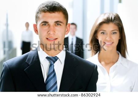 Young business people go down the corridor of modern office - stock photo
