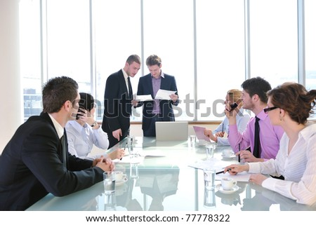 young business people group have  meeting at conference room and have discusion  about new ideas  plans and problems - stock photo