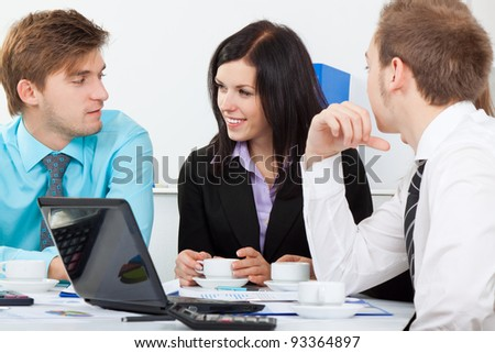 young business people happy smile talking, businessmen and women sitting at desk office discussing during working day, businesspeople paperwork - stock photo