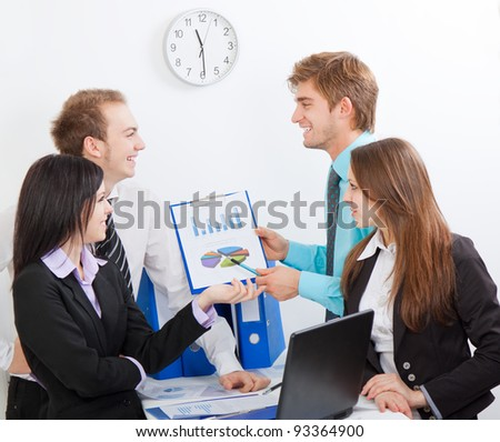 young business people happy smile working on project in team together, businessmen and women discussing the financial diagram, graph, business charts, businesspeople meeting sitting at desk office