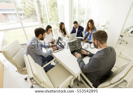 Young business people having meeting in modern office
