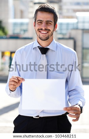 young business people holding a white paper