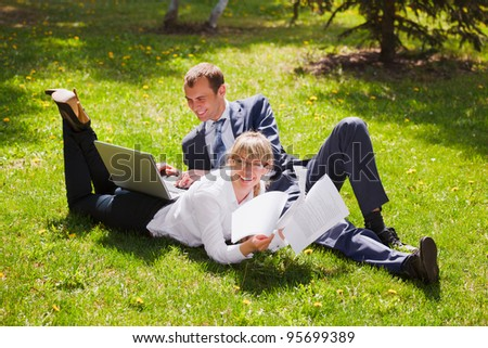 Young business people in a city park - stock photo
