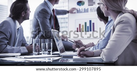 Young business people in board room meeting at the office - stock photo