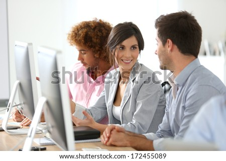 Young business people in office working together - stock photo