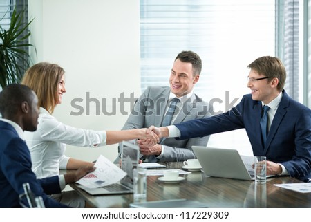 Young business people indoors - stock photo