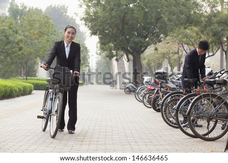 Young Business people parking their bikes in Beijing - stock photo