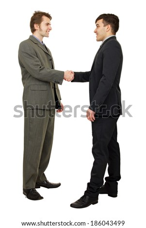 Young business people shaking hands, finishing up a meeting