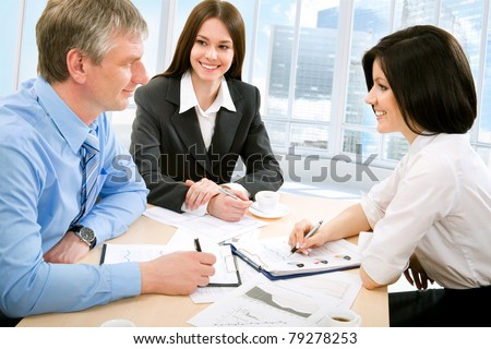 Young business people to discuss a new project - stock photo