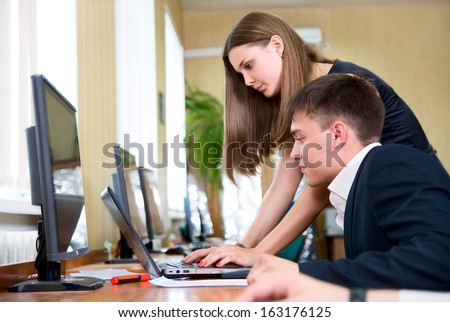 Young business people work in a computer class. Business team solves the problem in the office - stock photo