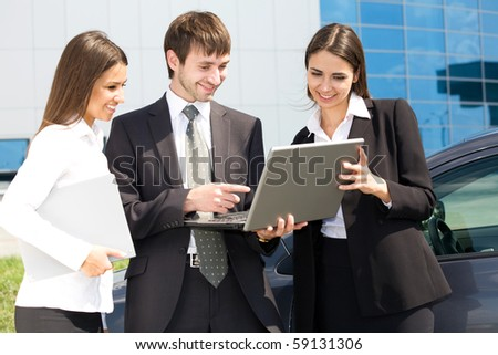 Young business people working against a building of modern office - stock photo