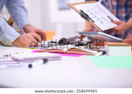 Young business people working at office on new project - stock photo