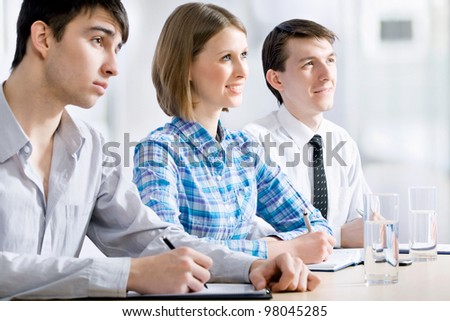 Young business people working at seminar - stock photo