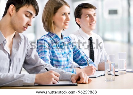 Young business people working at the office - stock photo