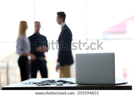 Young business people working in a conference room - stock photo