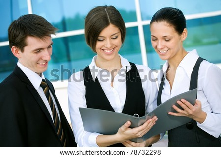 Young business people working in modern office building
