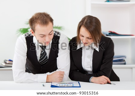 young business people working on project in team together, men and women discussing the problem, business plan, papers charts, document, businesspeople sitting at desk office
