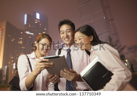 Young business people working outdoor - stock photo