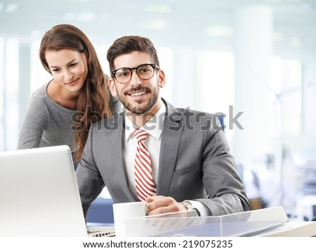Young business people working together on laptop.  - stock photo