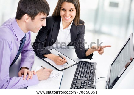 Young business people working with computer