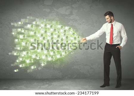 Young business person throwing money concept on background - stock photo