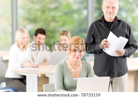 Young business students having meeting - businesswoman and manager in front - stock photo