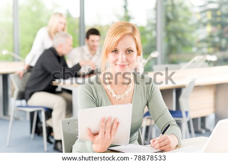 Young business students having meeting - businesswoman in front - stock photo