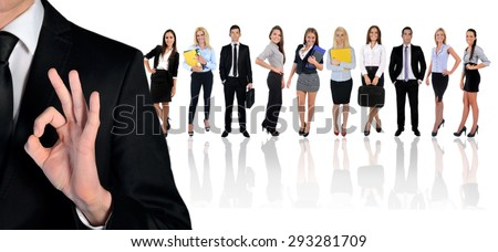 Young business team and ok sign - stock photo