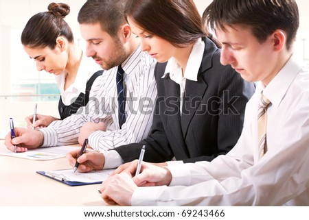 Young business team in an office - stock photo