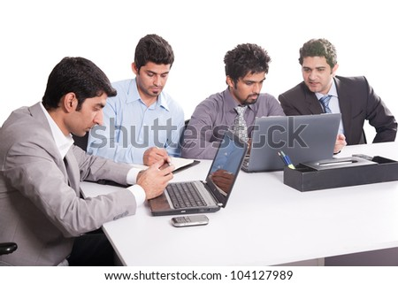 young business team in office meeting, young multiracial businessmen in official meeting - stock photo