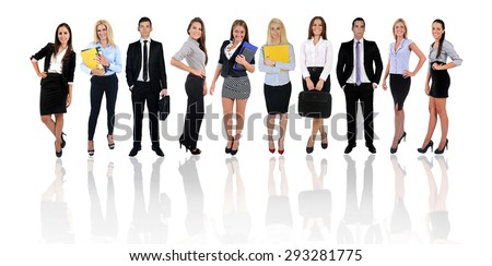 Young business team looking camera - stock photo