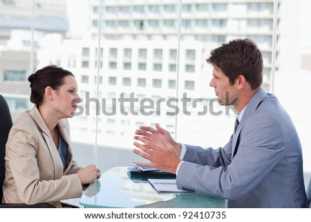 Young business team negotiating in a meeting - stock photo