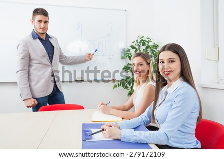 Young business team on a meeting in a conference room - stock photo