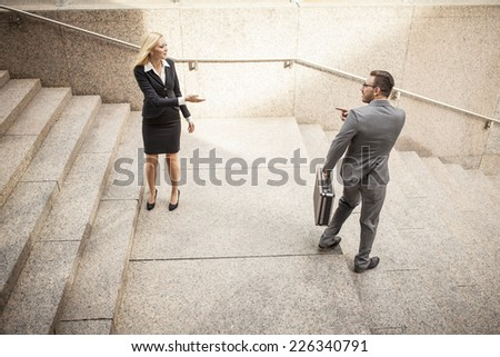 Young business team on the go in urban setting outside - stock photo