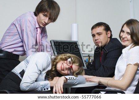Young business team with computer working in office