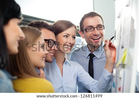 Young business team working in office - stock photo