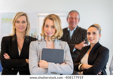 Young business woman and her team