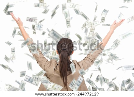 Young business woman and money banknotes flying in air on the white background. - stock photo