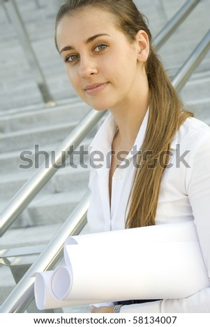 Young business woman architect / engineer plans - stock photo