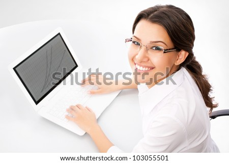 Young business woman at office