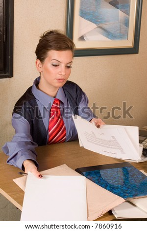 Young business woman at ofifce, image is detail from desk
