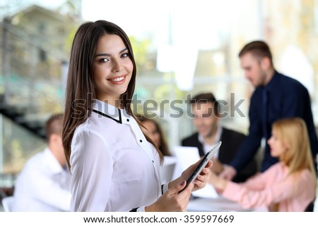 Young business woman at the meeting in a conference room - stock photo