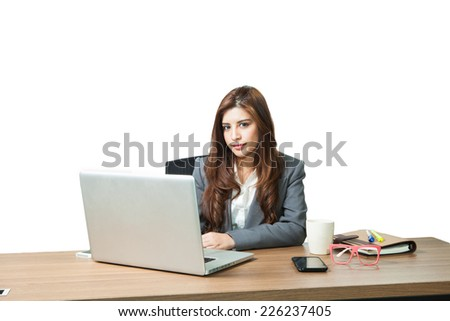 Young business woman attractive with laptop working on table in office - stock photo