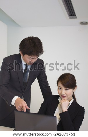 Young business woman being scolded for her mistakes - stock photo