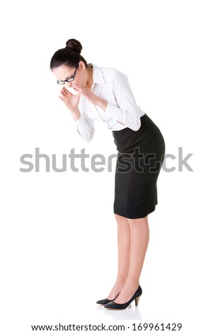 Young business woman bending down and looking. Isolated on white. - stock photo