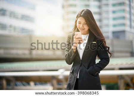 Young business woman calling on the cell phone - stock photo