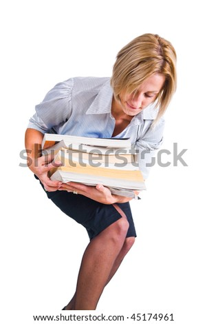 Young business woman carrying a pile of files or books.