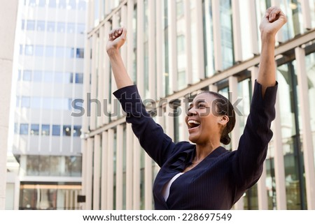 young business woman celebrating - stock photo