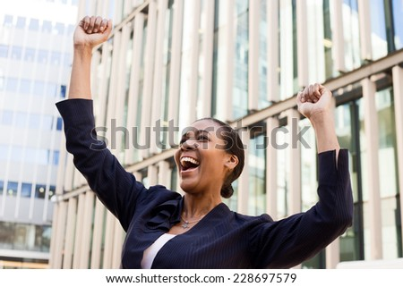 young business woman celebrating. - stock photo