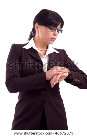 Young business woman checking her wrist watch isolated over white background - stock photo